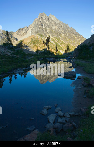 Mount Stuart reflected in still water at sunset Central Cascades Washington USA - Stock Photo