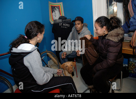 Youth chatting in the Rastafarian Community Centre in St Agnes Place Kennington South London. - Stock Photo