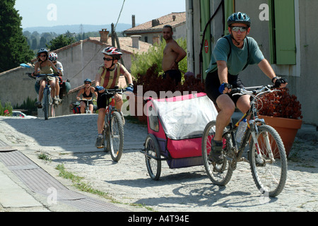 Family of Cyclists on the towpath of the Canal du Midi Southern France - Stock Photo
