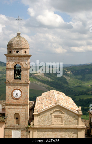 Monte San Martino clocktower where the clock is kept at a quirky twisted angle as a reminder of when the earthquake - Stock Photo