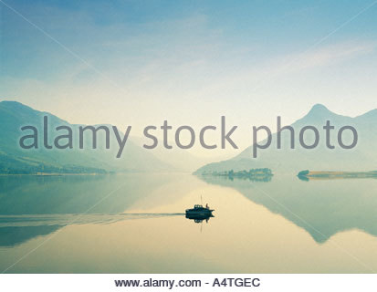 Man saltwater fishing from boat on Loch Leven at north end of Loch Linnhe, Glencoe near Fort William. Highland Region, - Stock Photo