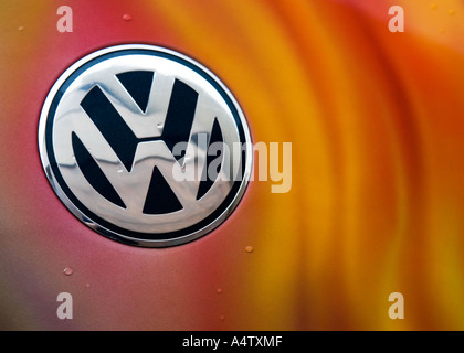 Orange flame artwork around a chrome Volkswagen Beetle badge in Singapore, Asia - Stock Photo