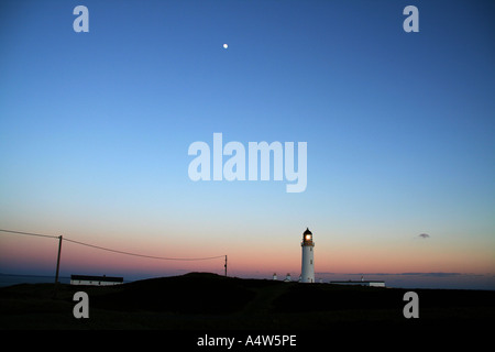 Sunset over Mull of Galloway Lighthouse, Scotland - Stock Photo