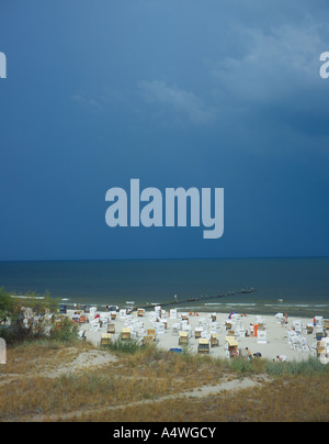 sandy beach and white wicker beach chairs at Heringsdorf, Mecklenburg Vorpommern, Usedom, Germany, Europe Photo - Stock Photo
