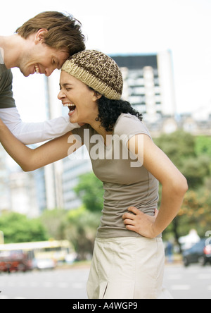 Young couple laughing - Stock Photo
