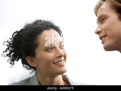 Woman and man conversing - Stock Photo