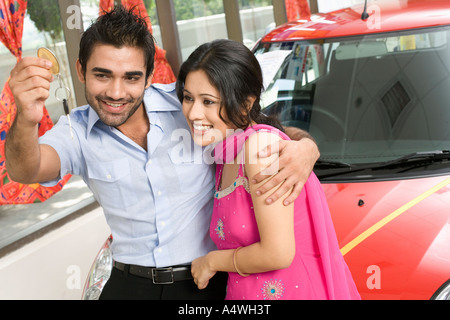 Couple buying new car - Stock Photo