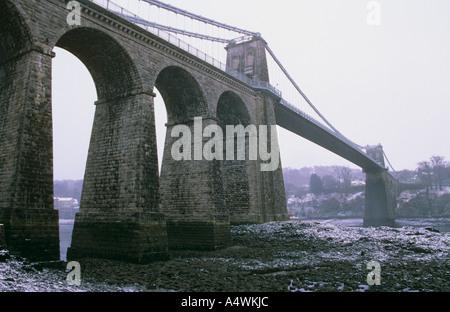Menai Bridge in the snow Anglesey - Stock Photo