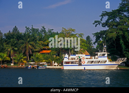 Sightseeing tour and fishing boat along Rio Dulce Dulce River El Relleno Izabal Department Guatemala Central America - Stock Photo