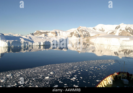 Ice breaker navigating the Lemaire Channel,'Kodak Gap',in Antarctica. - Stock Photo