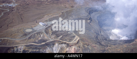 Smoking Mount Aso, Japan, with safety bunkers, car park and visitor centre. - Stock Photo