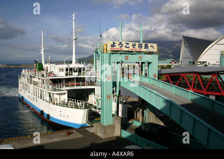 The ferry departs from the port on its way to Sakurajima Kagoshima Japan - Stock Photo
