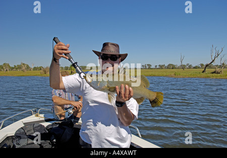Tourist with catched fish, barramundi, Lates calcarifer, Northern territory, australia - Stock Photo