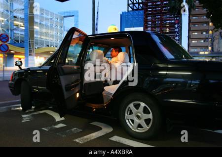 Taxi at Miyazaki Train Station, Miyazaki, Kyushu Island, Japan - Stock Photo