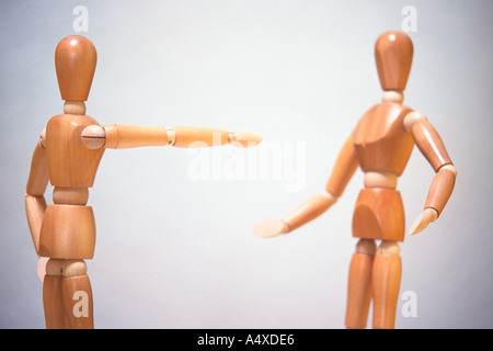 Angry mannequin blaming another - Stock Photo