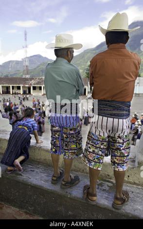 GUATEMALA SANTIAGO ATITLAN Indigenous Maya Tzutujil men in traditional woven embroidered pants and sash - Stock Photo