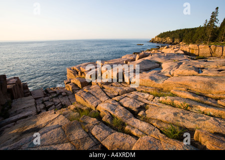 Early morning on the pink granite ledges of the rocky coast of Maine USA - Stock Photo