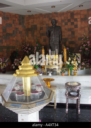 The shrine inside Wat Phu Tok s marble chedi commemorating its founder in north east Thailand - Stock Photo
