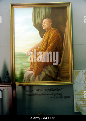 A painting of Phra Ajaan Juen founder of Wat Phu Tok inside the chedi built to commemorate him in north east Thailand - Stock Photo