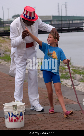 Man in American patriotic outfit performs with little girl New Orleans LA USA - Stock Photo
