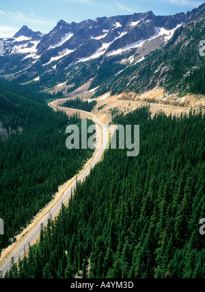 North Cascades Highway through the Cascade Mountains takes a hairpin bend below the Early Winters Spires Washington - Stock Photo