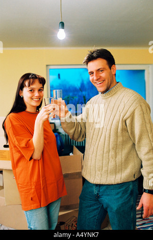 Young couple moving - Stock Photo