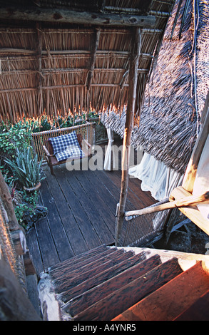simple interior of one of the elevated luxury treehouses built around a giant boabab tree at Chole Mjini Mafia island - Stock Photo