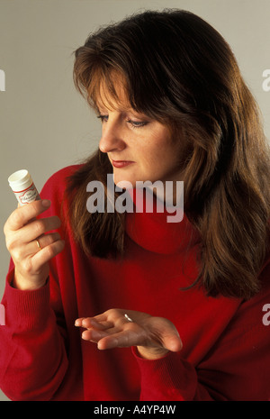 woman taking homeopathic remedy - Stock Photo