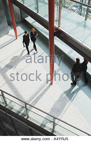 People walking through office building - Stock Photo