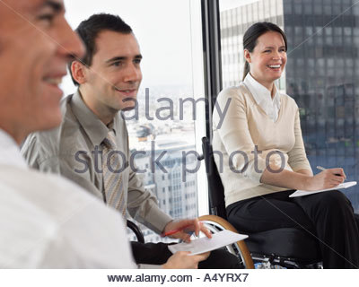 Three office workers in meeting - Stock Photo