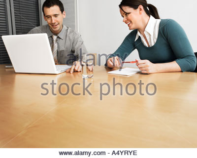 Two office workers in meeting - Stock Photo