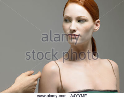 Woman having her arm touched - Stock Photo