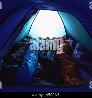 Children in sleeping bags inside tent - Stock Photo