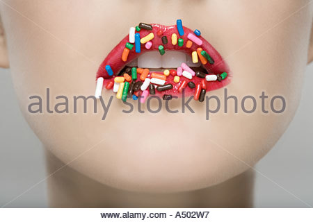 Woman with sugar sprinkles on her lips - Stock Photo