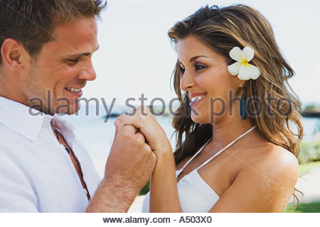 Man holding womans hand - Stock Photo