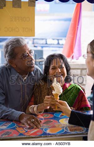 Mature couple getting an ice cream - Stock Photo