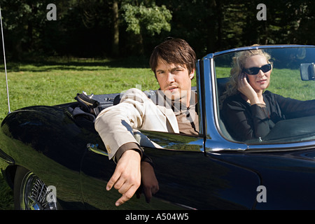 Stylish couple in convertible - Stock Photo