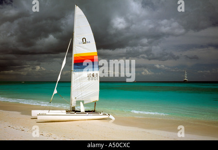 Idle sailboat on a beach in Playa del Carmen at the Riviera Maya on the Mexican peninsula of Yucatan. - Stock Photo