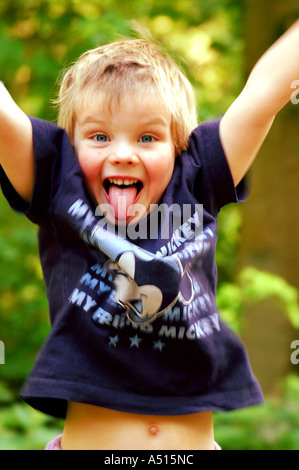 Happy days! young child playing in summer woods. - Stock Photo