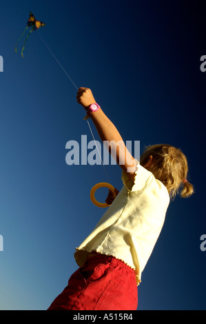 Child flying a kite on a sunny afternoon - Stock Photo