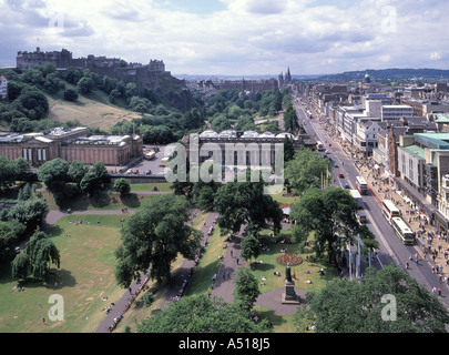 Edinburgh part of Princes Street and gardens with castle beyond - Stock Photo