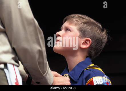 Boy Scout straightening neckerchief of Cub Scout User needs to obtain specific permission from Boy Scouts of America - Stock Photo
