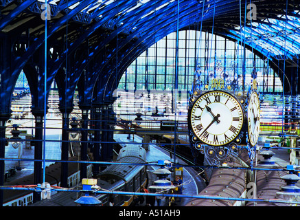 The newly  restored London Brighton and South Coast Railway Clock under the station canopy - Stock Photo