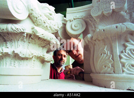 Training a young craftsman to become a stonemason - Stock Photo
