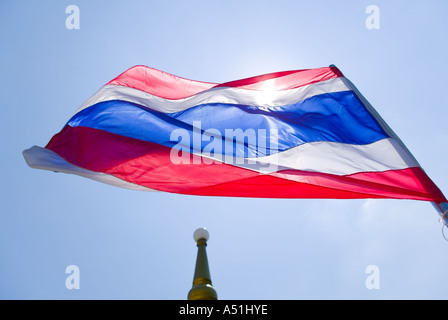 Flag of Thailand flying over Chedi - Stock Photo
