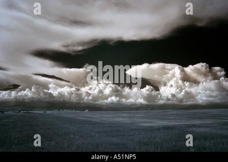 Infrared photo of approaching cumulonimbus thunderstorm clouds taken using a digital camera near Bury St Edmunds - Stock Photo