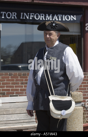 Certified Colonial guide wearing three cornered hat stands in front of tourist information office in Annapolis Maryland - Stock Photo