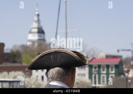 Certified Colonial guide wearing three cornered hat stands near the waterfront in Annapolis Maryland USA - Stock Photo