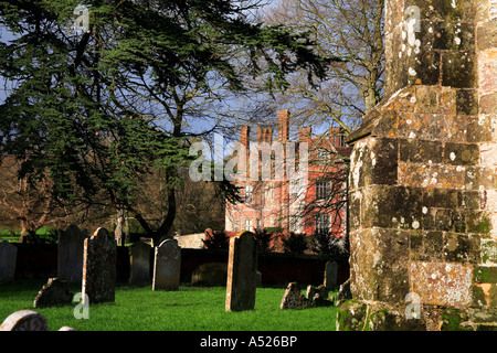 Breamore Church graveyard and Breamore Manor Hampshire England - Stock Photo