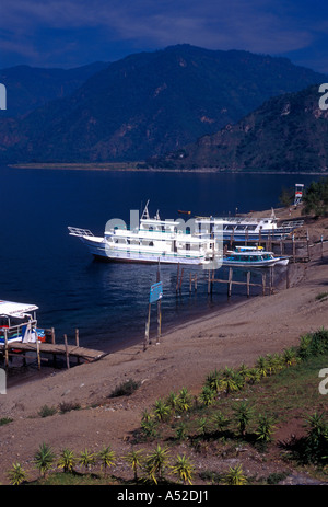 Boats at dock ferry boat service on Lake Atitlan in the town of Panajachel in Solola Department Guatemala Central - Stock Photo